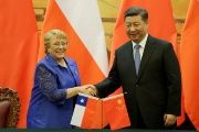 Chilean President Michelle Bachelet (L) and Chinese President Xi Jinping attend a signing ceremony in Beijing, China on May 13, 2017.