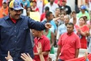 Venezuelan President Nicolas Maduro(L) greets supporters during a rally at the Miraflores presidential palace in Caracas, on May 11, 2016.