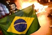 A demonstrator holds a Brazilian national flag during a protest turned violent, in downtown Rio de Janeiro.