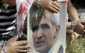 Palestinians carry a poster depicting Ahmed Saadat, leader of the PFLP, during a protest at the Ain el-Hilweh refugee camp, southern Lebanon in 2009.