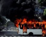 A group of hooded men in Caracas took a public bus driver hostage on Saturday and then set his vehicle on fire.