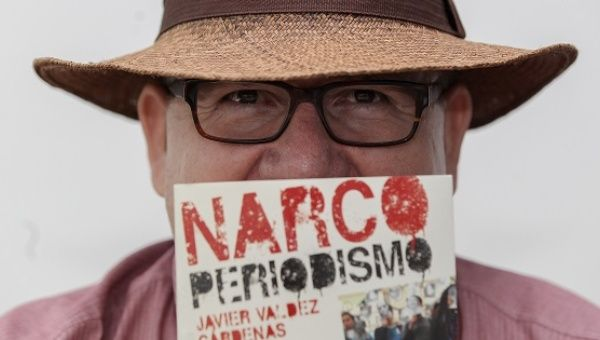 "Javier Valdez poses with his book ""Narco-Journalism."""