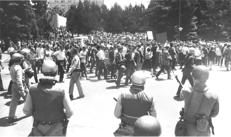 Highway patrolmen and national guard soldiers blocking demonstrators in Berkeley, California.