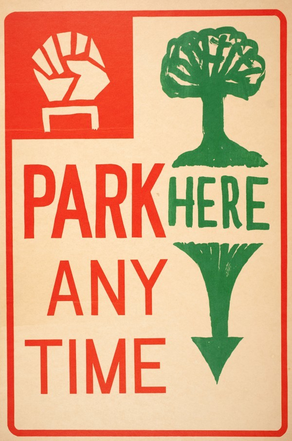 A protest sign satirizing traditional parking signs.