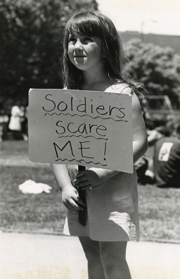 A young girl protests at a march called a day before Governor Reagan called in the national guard to take control of the park.
