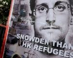 Refugees and protesters supporting Edward Snowden demonstrate outside the U.S. Consulate in Hong Kong, Sept. 25, 2016.