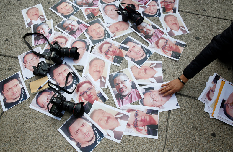 Pictures of journalists who have been killed in Mexico are seen during a demonstration against the murder of journalist Javier Valdez.