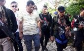 President of the Philippines, Rodrigo Duterte, walks with rebels from the New People