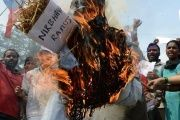 Communist Party of India activists burn an effigy representing the rapists of Delhi student,