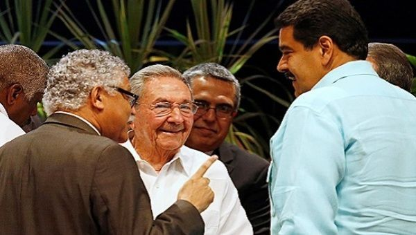 Secretary General of the Association of Caribbean States Alfonso Munera with Cuban President Raul Castro and Venezuela