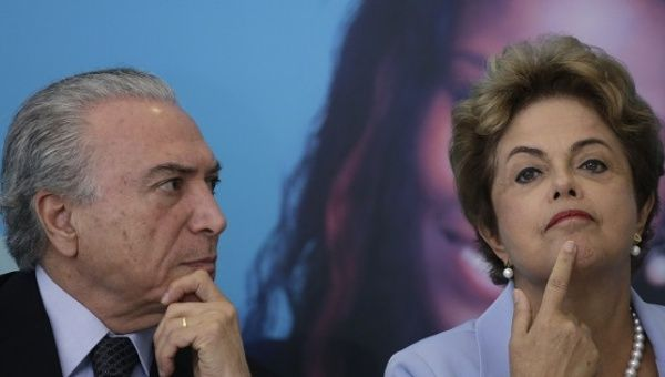 Former President Dilma Rousseff and then-Vice President Michel Temer announce a new electricity investment plan in Brasilia, Aug. 11, 2015.