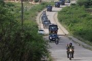 Military buses transporting gang members leave the Marco Aurelio Soto prison in Tegucigalpa, Honduras, on May 16, 2017.