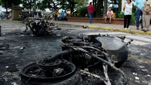Burnt police motorcycles are seen during a protest against Venezuela