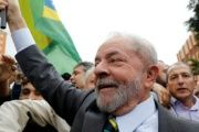 Lula walks with supporters before his first deposition.