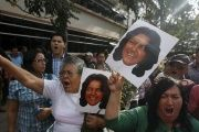 Activists hold photos of slain Honduran environmental activist Berta Caceres.