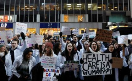 Demonstrators protest a proposed repeal of the Affordable Care Act.