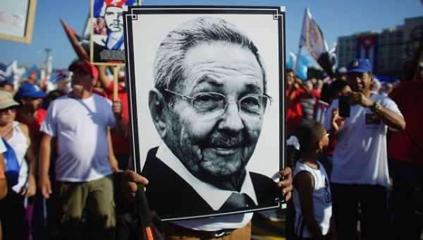 A person carries a picture of Cuban President Raul Castro during a May Day rally in Havana.