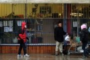 Homeless residents of the Downtown Eastside, in Vancouver, British Colombia, seek shelter from the rain.