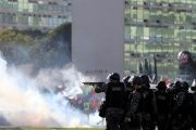 Riot police attack protests against President Michel Temer and the latest corruption scandal to hit the country, in Brasilia, Brazil, May 24, 2017.