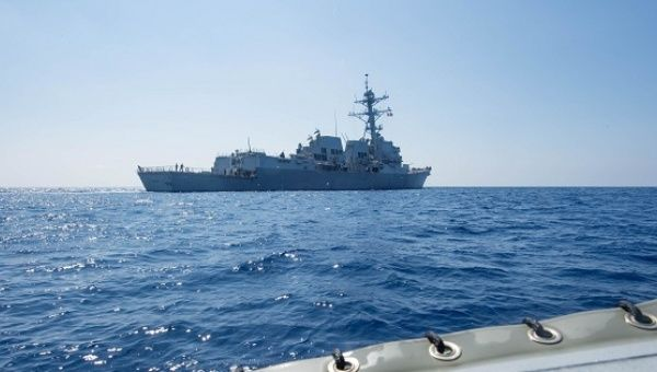 Arleigh Burke-class guided-missile destroyer USS Dewey transits the South China Sea.