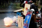 Opposition protesters use home-made mortars while clashing with Venezuelan security forces.