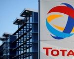 The logo of French oil giant Total is seen in front of the oil refinery of Donges, near Nantes, France, December 20, 2013.