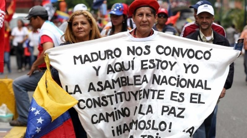 Protesters in Caracas, Venezuela march in defense of the national constituent assembly.
