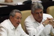 Cuba's President Raul Castro (L) speaks with Vice-President Miguel Diaz-Canel (R) during a session of the National Assembly in Havana, December 20, 2014. The Cuban Vice-President affirmed support for Ecuador's newly sworn-in President Lenin Moreno.