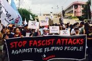 Protesters with progressive human rights group Karapatan march in Manila, Philippines, on Friday May 26, 2017.
