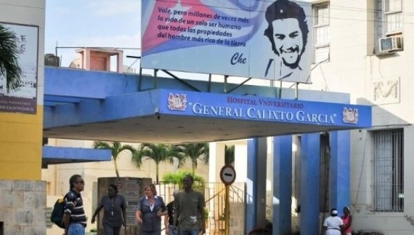 A Che Guevara quote is seen at the entrance to a hospital in Havana, Cuba.