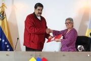 Venezuela's President Nicolas Maduro stands next to Venezuela's National Electoral Council President Tibisay Lucena during a meeting in Caracas.