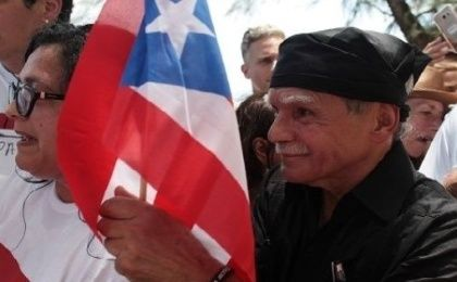 Puerto Rican Oscar Lopez Rivera (C) carries a national flag as he meets with supporters after being released from house arrest in San Juan, Puerto Rico.