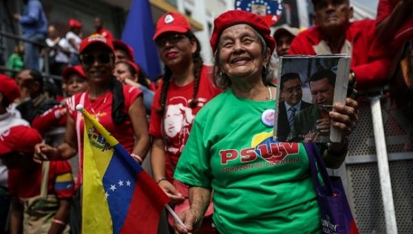 Supporters of the Venezuelan government march against an OAS meeting on the situation in Venezuela in Caracas, March 28, 2017.