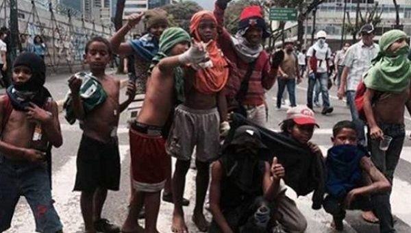 Children taking part in opposition protests in Venezuela.