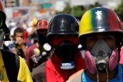 Right-wing demonstrators wearing gas masks take part in a protests in Caracas, Venezuela, May 29, 2017.