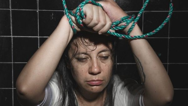 "Ecuadorean photographer and performance artist Paola Peredes playing the role of one of the victims of torture clinics to ""treat"" homosexuality."