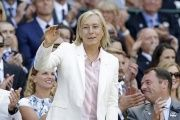 Martina Navratilova waves to supporters.