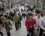 Commuters make their way through a subway station in the DPRK.