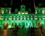 Green lights are projected onto the facade of the Hotel de Ville in Paris, France, after U.S. President Donald Trump announced his decision  June 1, 2017.