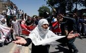 An Afghan woman chants slogans during a protest in Kabul, Afghanistan.