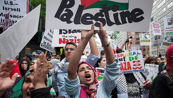 "Protesters shout, ""Free Palestine,"" during a march demanding an end to the Israeli aggression in Gaza, New York, July 9, 2014."