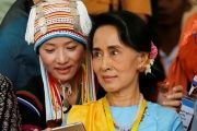An ethnic woman takes a selfie with Myanmar State Counsellor Aung San Suu Kyi in Naypyitaw, Myanmar, on May 24, 2017.