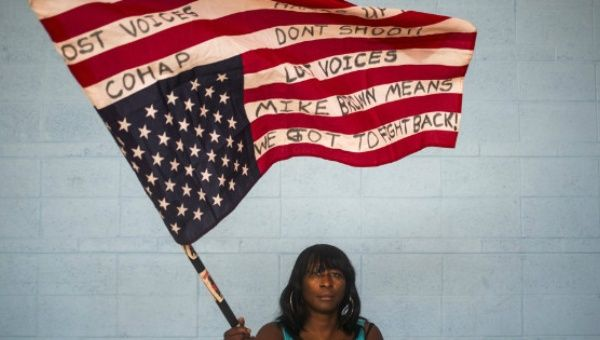 Black woman holding the U.S. flag