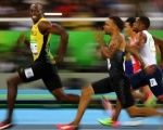 Usain Bolt of Jamaica smiles as he looks back at his competition, while winning the 100-meter semi-final sprint, at the 2016 Olympics in Rio de Janeiro, Brazil.