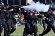 Riot police officers clash with demonstrators during a protest against right-wing Brazilian President Michel Temer.