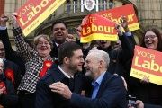 Labour leader Jeremy Corbyn pictured hugging new MP Jim McMahon as he said the result shows