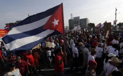 A man waves a Cuban flag in Havana