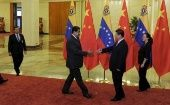China and Venezuela have been historic economic allies. Venezuelan President Maduro (L) meets with President Xi Jinping (R) of China are seen meeting in 2015.