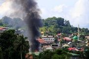 Smoke rises as government troops continue their assault on insurgents in Marawi, southern Philippines, June 10, 2017