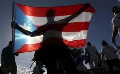 A protester holding a Puerto Rican flag.